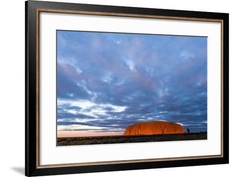 A Cloud Bank from an Approaching Storm Turns Magenta as it Shrouds Uluru and the Desert Plain-Jason Edwards-Framed Art Print