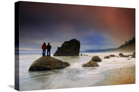 A Couple Stands on a Rock at Sunset on Ruby Beach, Olympic National Park, Washington-Keith Ladzinski-Stretched Canvas Print