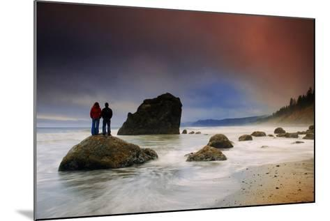 A Couple Stands on a Rock at Sunset on Ruby Beach, Olympic National Park, Washington-Keith Ladzinski-Mounted Photographic Print