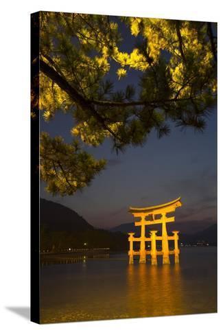 The 'Floating' Torii Gate of the Itsukushima Shinto Shrine, Illuminated at High Tide-Macduff Everton-Stretched Canvas Print