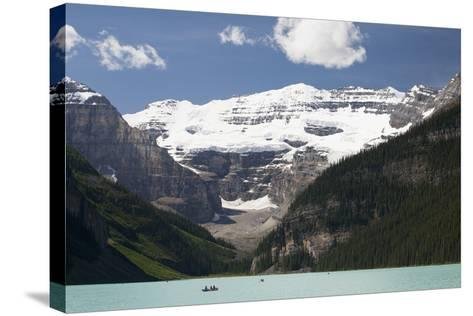Mount Victoria and Lake Louise with Canoes-Design Pics Inc-Stretched Canvas Print