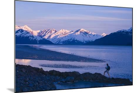 Hiker at Dusk on Ridge Overlooking Turnagain Arm with Sun Setting on Chugach Mountains-Design Pics Inc-Mounted Photographic Print