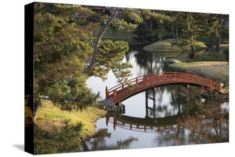 A Footbridge over Water in a Garden-Macduff Everton-Stretched Canvas Print