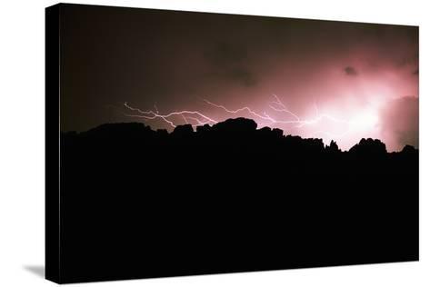 Lightning over Devil's Backbone, Loveland, Colorado-Keith Ladzinski-Stretched Canvas Print
