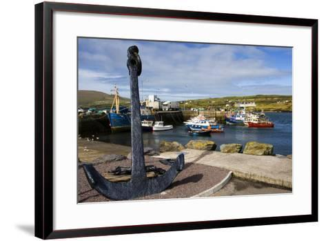 An Anchor Stands on the Shore Overlooking Fishing Boats in Portmagee-Chris Hill-Framed Art Print