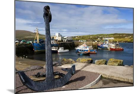 An Anchor Stands on the Shore Overlooking Fishing Boats in Portmagee-Chris Hill-Mounted Photographic Print