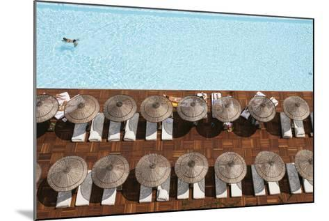 Man Swimming in Pool by Sunloungers, Aerial View-Design Pics Inc-Mounted Photographic Print