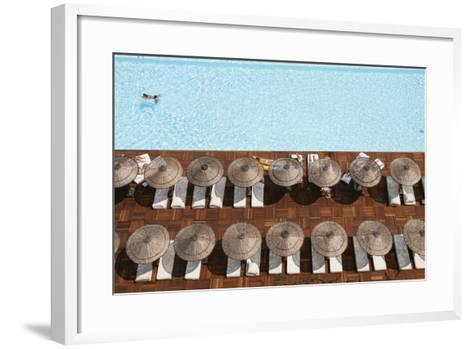 Man Swimming in Pool by Sunloungers, Aerial View-Design Pics Inc-Framed Art Print