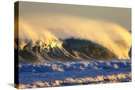 Late Afternoon Light Illuminates a Winter Wave Off the Coast of Maine-Robbie George-Stretched Canvas Print
