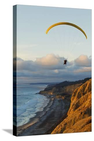 California, La Jolla, Paraglider Flying over Ocean Cliffs at Sunset. Editorial Use Only-Design Pics Inc-Stretched Canvas Print