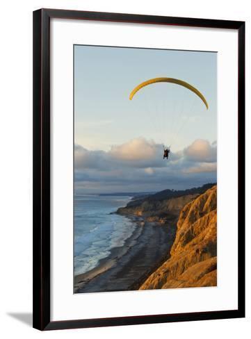 California, La Jolla, Paraglider Flying over Ocean Cliffs at Sunset. Editorial Use Only-Design Pics Inc-Framed Art Print