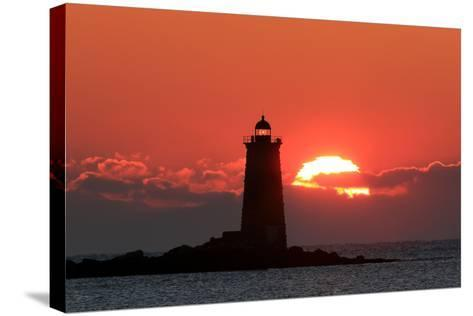 The Sun Rises Behind Whaleback Light Offshore from Kittery, Maine-Robbie George-Stretched Canvas Print