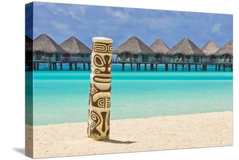 A Tiki Totem Pole on the Beach at the Le Meridien Resort-Mike Theiss-Stretched Canvas Print