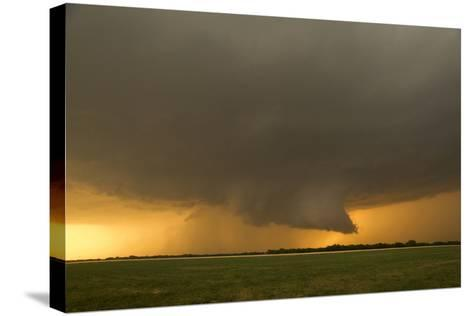 A Tornado-Warned Supercell Thunderstorm Produces a Well-Defined Wall Cloud over a Farm Field-Jim Reed-Stretched Canvas Print