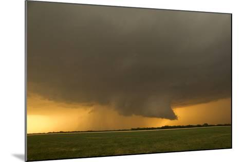 A Tornado-Warned Supercell Thunderstorm Produces a Well-Defined Wall Cloud over a Farm Field-Jim Reed-Mounted Photographic Print