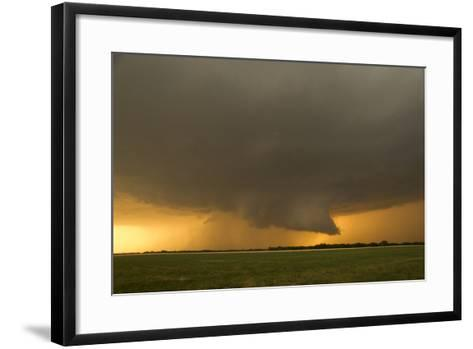 A Tornado-Warned Supercell Thunderstorm Produces a Well-Defined Wall Cloud over a Farm Field-Jim Reed-Framed Art Print