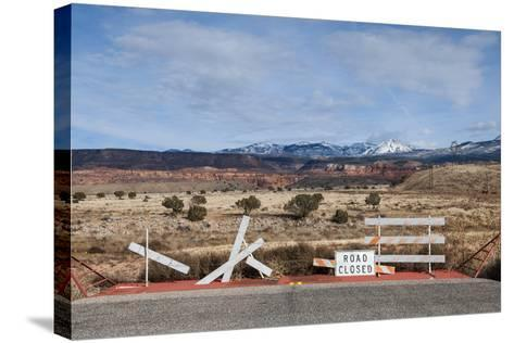 An Asphalt Road Comes to an Abrupt End Just before a Spectacular Landscape-Jim Reed-Stretched Canvas Print