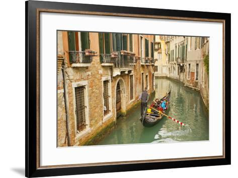 Tourists Ride in a Gondola in a Canal Winding Through Venice-Mike Theiss-Framed Art Print