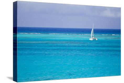 A Lone Sailboat in Turquoise Caribbean Waters Just Offshore-Mike Theiss-Stretched Canvas Print
