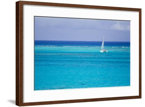 A Lone Sailboat in Turquoise Caribbean Waters Just Offshore-Mike Theiss-Framed Art Print