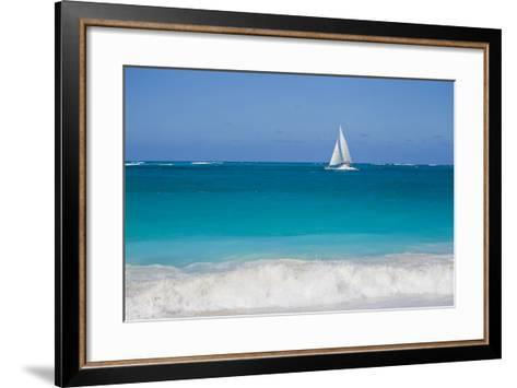 Surf Surges onto a Beach as a Sailboat Passes Offshore-Mike Theiss-Framed Art Print