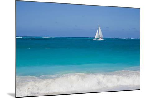Surf Surges onto a Beach as a Sailboat Passes Offshore-Mike Theiss-Mounted Photographic Print