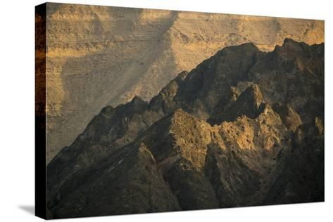 Craggy Coastline Off Oman-Michael Melford-Stretched Canvas Print
