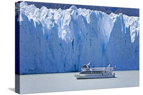 Tourist in a Boat Close to Perito Moreno Glacier Hope to Witness Calving-Mike Theiss-Stretched Canvas Print