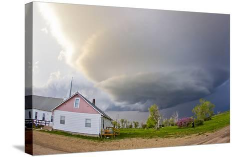 A Rotating Mesocyclone Supercell Thunderstorm Filling the Sky over a Small Church-Mike Theiss-Stretched Canvas Print