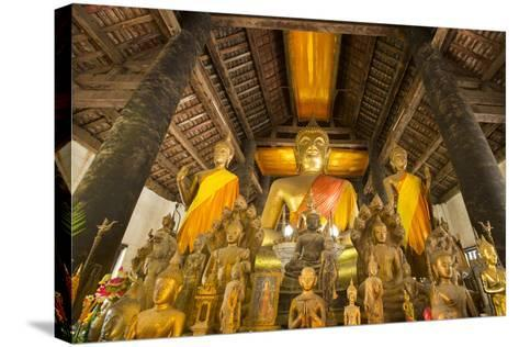 Buddha Statues Inside Wat Visoun, or Commonly known as That Makmo-Michael Melford-Stretched Canvas Print