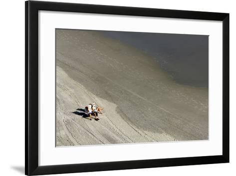 A Couple Relax While Reading Newspapers at the Beach-Jim Reed-Framed Art Print