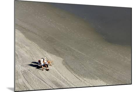 A Couple Relax While Reading Newspapers at the Beach-Jim Reed-Mounted Photographic Print