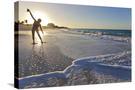 A Woman Standing in Front of the Sun Glows and Casts a Shadow on the Beach-Mike Theiss-Stretched Canvas Print