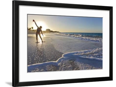 A Woman Standing in Front of the Sun Glows and Casts a Shadow on the Beach-Mike Theiss-Framed Art Print