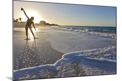 A Woman Standing in Front of the Sun Glows and Casts a Shadow on the Beach-Mike Theiss-Mounted Photographic Print