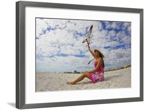 A Laughing Gull Swoops Down for a Cookie in a Woman's Hand at the Beach-Mike Theiss-Framed Art Print