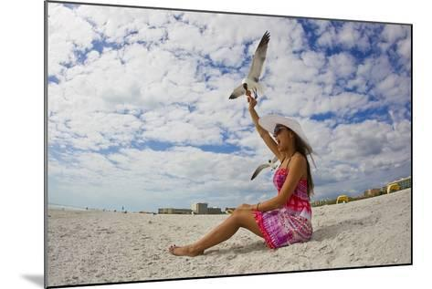 A Laughing Gull Swoops Down for a Cookie in a Woman's Hand at the Beach-Mike Theiss-Mounted Photographic Print