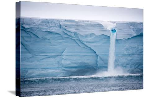 Meltwater Pours over an Ice Cliff from the Surface of the Nordaustlandet Ice Cap-Michael Melford-Stretched Canvas Print