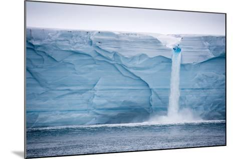 Meltwater Pours over an Ice Cliff from the Surface of the Nordaustlandet Ice Cap-Michael Melford-Mounted Photographic Print