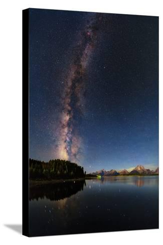 The Night Sky over the Grand Teton National Park and the Jackson Lake Dam-Babak Tafreshi-Stretched Canvas Print