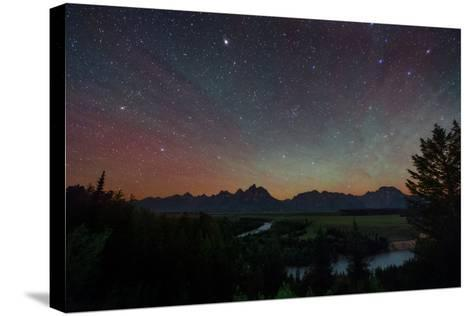 The Night Sky over the Grand Teton National Park and the Snake River-Babak Tafreshi-Stretched Canvas Print