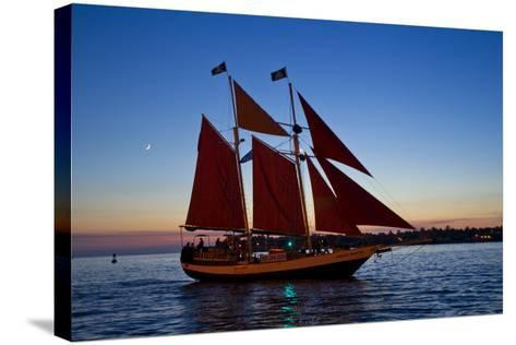 A Sailboat Carrying Tourists Returns to Port after a Sunset Sail-Mike Theiss-Stretched Canvas Print