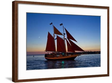 A Sailboat Carrying Tourists Returns to Port after a Sunset Sail-Mike Theiss-Framed Art Print
