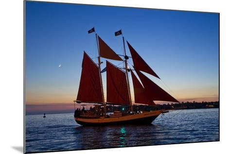 A Sailboat Carrying Tourists Returns to Port after a Sunset Sail-Mike Theiss-Mounted Photographic Print
