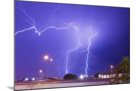 Multiple Lightning Bolts Stike from an Intense Lightning Thunderstorm-Mike Theiss-Mounted Photographic Print