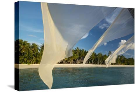 Diaphanous Curtains Flapping in the Breeze at a Resort in the Maldives-Michael Melford-Stretched Canvas Print