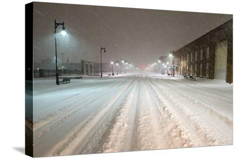A Snowstorm Strikes a City in the Middle of the Night-Jim Reed-Stretched Canvas Print
