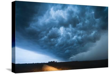 A Picturesque Supercell Thunderstorm at Twilight-Jim Reed-Stretched Canvas Print