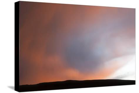 A Thunderstorm Produces a Rain Foot at Sunset-Jim Reed-Stretched Canvas Print
