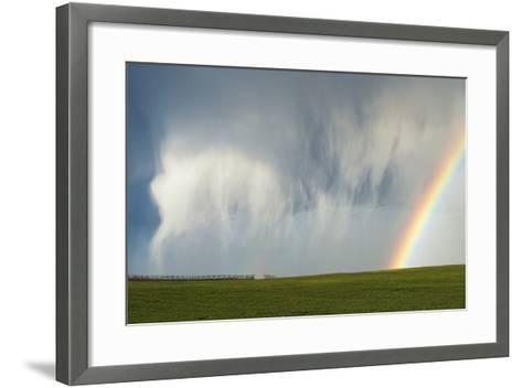 A Thunderstorm Produces a Curtain of Falling Hailstones Next to a Rainbow-Jim Reed-Framed Art Print